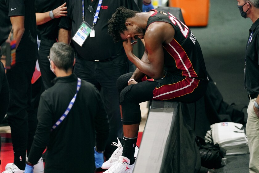 Miami Heat star Jimmy Butler winces in pain during Game 1 of the NBA Finals against the Lakers on Sept. 30.