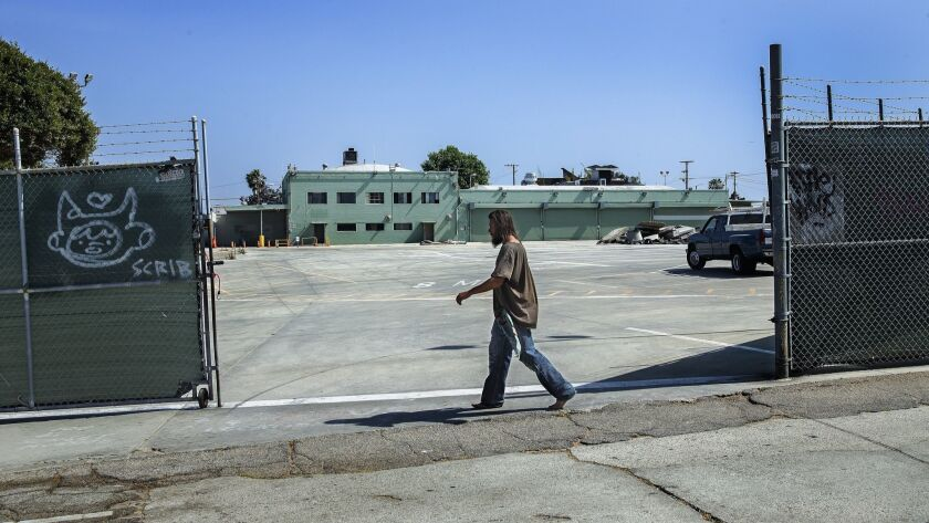 VENICE, CA-APRIL 25, 2019: A pedestrian walks past the entrance to a former MTA facility on Sunset