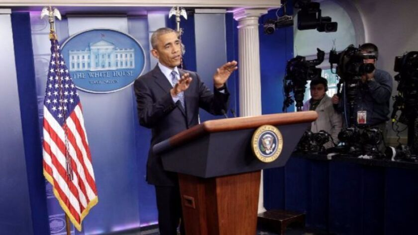 President Obama gestures Wednesday during his final news conference as the nation's leader.
