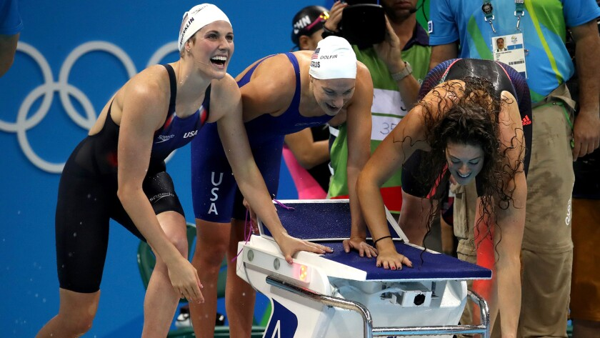 Although Missy Franklin, left, did not swim on the gold medal-winning 800-meter freestyle relay team, she was all smiles when helping the team advance through qualifying.