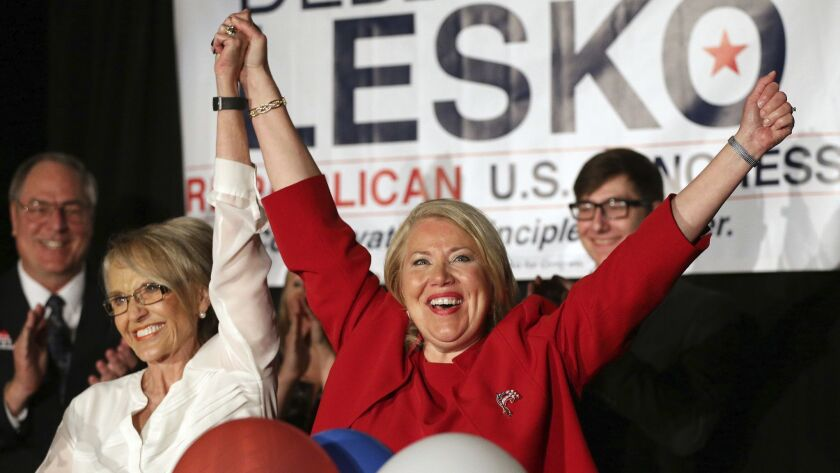 Republican congressional candidate Debbie Lesko, right, celebrates her win with former Arizona Gov. Jan Brewer on April 24.