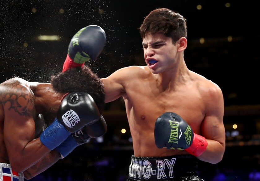 Ryan Garcia, right, lands a punch to the head of Braulio Rodriguez during their super-featherweight bout at Madison Square Garden in December.