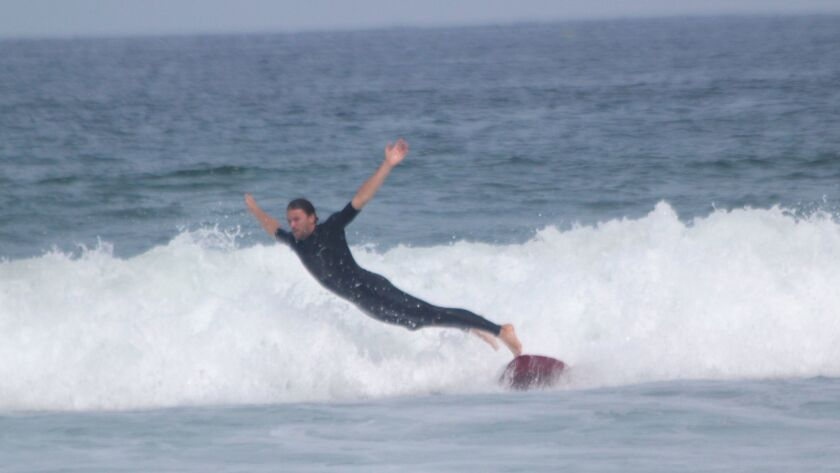 SIO post doctoral student Nick Pizzo cathing waves at a surf session July 18 near Scripps Pier.