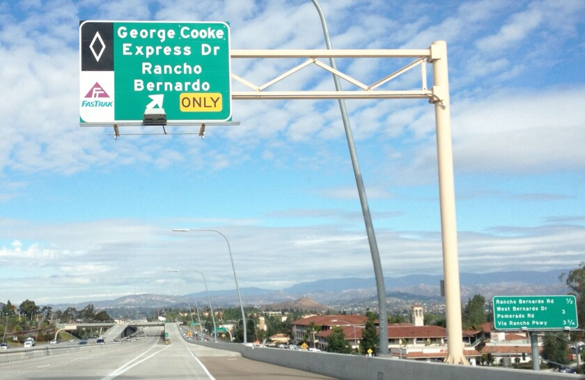 One of several freeway signs along Interstate 15 near Rancho Bernardo for George Cooke Express Drive.