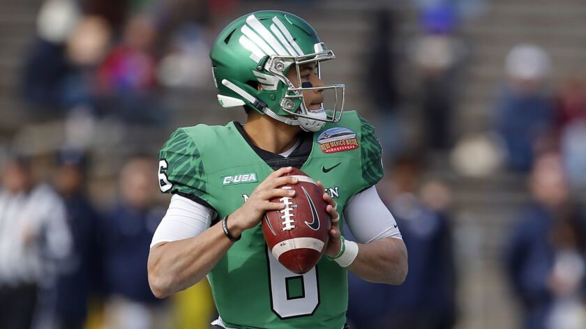 North Texas quarterback Mason Fine (6) looks to throw a pass during the first half of the New Mexico