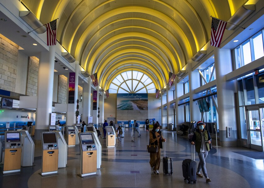Travelers walk inside Terminal 4 at Los Angeles International Airport on Dec. 31.