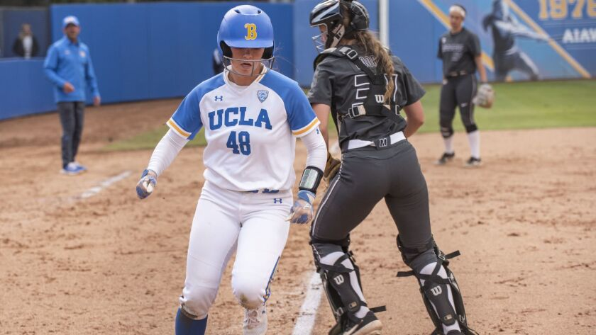 UCLA junior Bubba Nickles scores during game two of the NCAA Los Angeles Regional Championship again