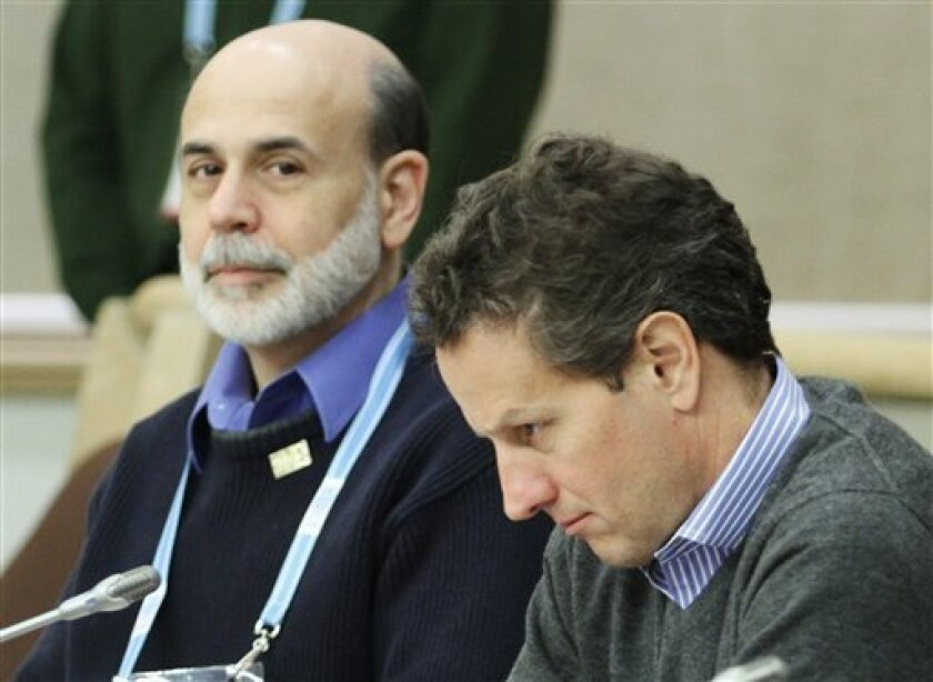 U.S. Treasury Secretary Tim Geithner, right, and Federal Reserve Chairman Ben Bernanke look on as they take part in G7 Finance Ministers talks in the Nunavut Legislative Assembly for their first formal talks in the Canadian northern community of Iqaluit, Nunavut,in Ontario Saturday, Feb. 6, 2010. (AP Photo/The Canadian Press, Fred Chartrand)