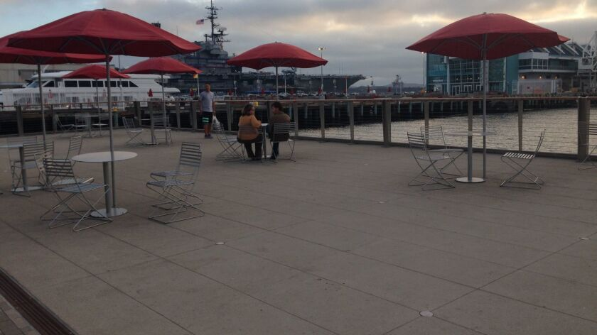 The overlook deck at the foot of Broadway draws almost no users at sunset. Critics say it needs more