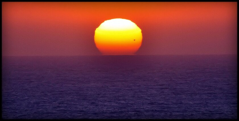 This shot (Venus black dot bottom right) was taken by local photographer Greg Wiest,