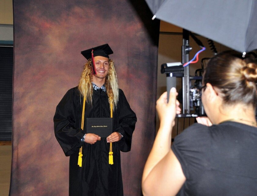 Chance Baldwin has his photograph taken after receiving his diploma. (La Jolla High School's Class of 2016 graduation ceremony, June 21 at UC San Diego's RIMAC Arena)