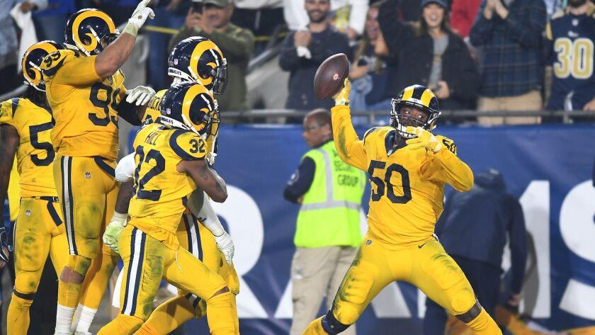 LOS ANGELES, CALIFORNIA NOVEMBER 19, 2018-Rams linebacker Samson Ebukam spikes the ball after interc