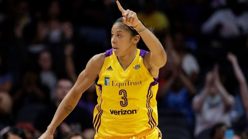 Sparks' Candace Parker celebrates her basket against the New York Liberty during the second half on Aug. 4.
