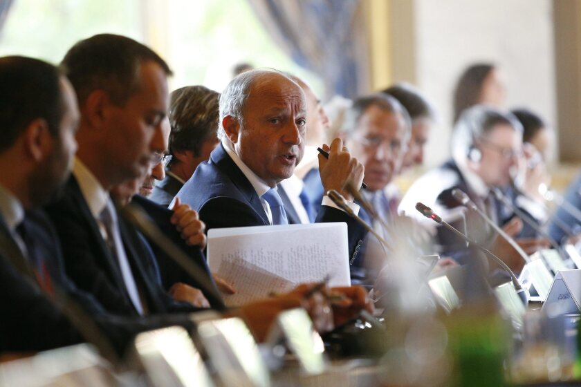 French Foreign Minister Laurent Fabius, center, speaks at an emergency summit Monday in Paris regarding the international response to the Islamic State militant group.