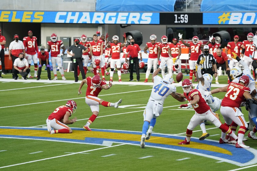 Chiefs kicker Harrison Butker (7) hits the winning field goal during overtime Sunday against the Chargers.