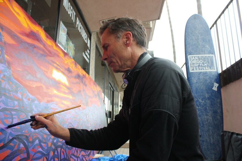 Damian Fulton creates a mural in front of the Misfit Pictures headquarters at 565 Pearl St. in La Jolla.
