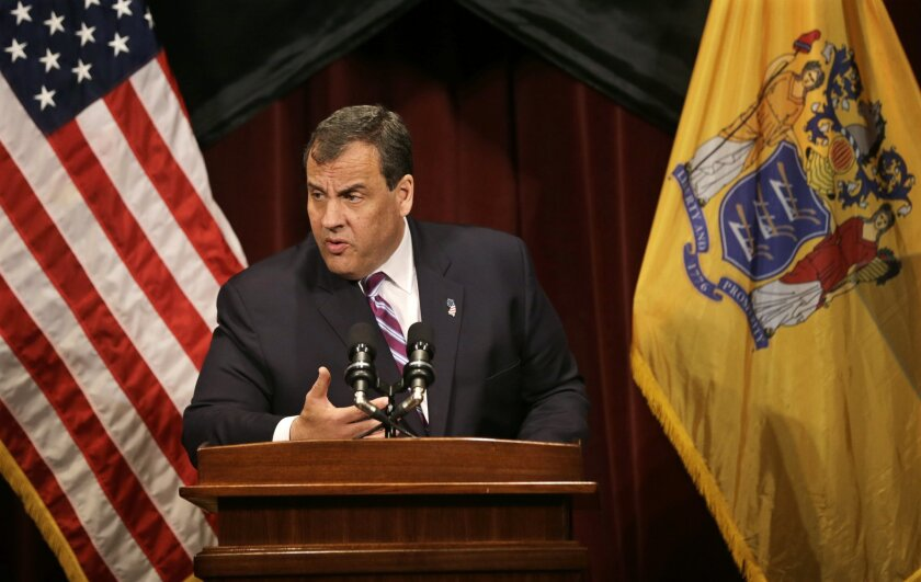 New Jersey Gov. Chris Christie addresses a gathering at Burlington County College Thursday, May 28, 2015, in Pemberton, N.J. Christie is backing away from the use of Common Core school standards, saying the system isn't working for students in New Jersey. (AP Photo/Mel Evans)