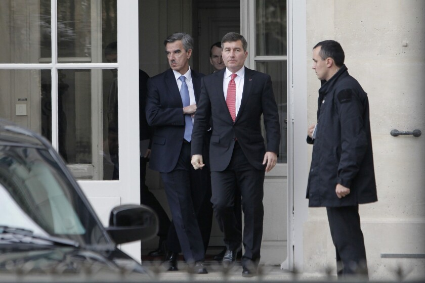 U.S Ambassador to France Charles H. Rivkin, right, leaves the Foreign Ministry in Paris, after he was summoned Monday. The French government was asked to explain why the Americans spied on one of their closest allies.