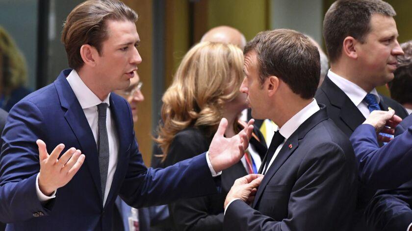 Austrian Chancellor Sebastian Kurz, left, speaks with French President Emmanuel Macron at an EU summit in Brussels on June 28.