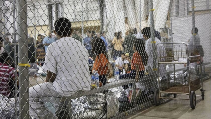 In this photo provided by U.S. Customs and Border Protection, people who've been taken into custody