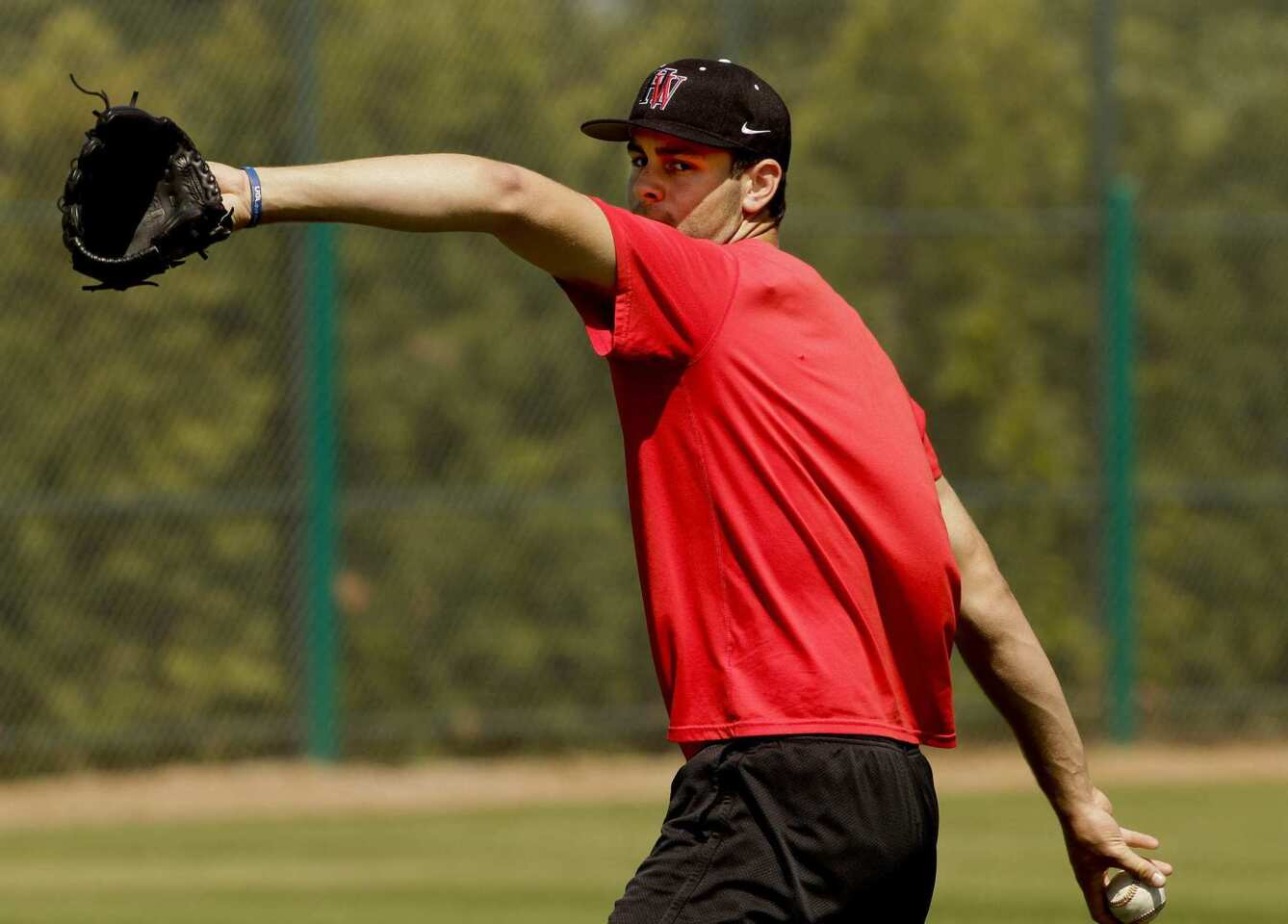 Lucas Giolito of Harvard-Westlake High pitches in public for the first time since rehabilitation from an elbow injury this spring during a workout at O'Malley Family Field in Encino.