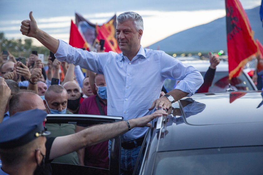 Kosovo President Hashim Thaci greets former members of the so-called Kosovo Liberation army, which fought for independence from Serbia, and other supporters waiting for his return at the border crossing points in Vrmice, Kosovo, Friday, July 17, 2020. Thaci was warmly welcomed by supporters upon return from the Netherlands where he was questioned by prosecutors at a special international court on alleged crimes during the 1998-1999 war after which his country won independence from Serbia. (AP Photo/Visar Kryeziu)