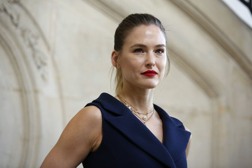 FILE - In this Feb. 26, 2019 file photo, Israeli top model Bar Refaeli poses for photographers at the Dior ready to wear Fall-Winter 2019-2020 collection, in Paris. Refaeli has signed a plea bargain agreement with authorities to settle a long-standing tax evasion case against her and her family. The deal will require Refaeli to serve nine months of community service while her mother will be sent to prison for 16 months. The two are also ordered to pay a $1.5 million fine on top of millions of back taxes owed to the state. (AP Photo/Thibault Camus, File)