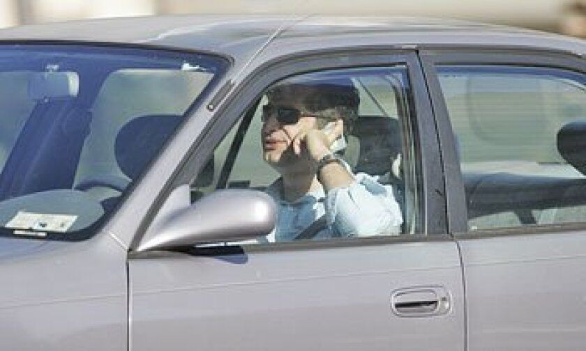 The California Highway Patrol issued about 12,500 tickets in May to motorists statewide for cell phone violations. (Sean M. Haffey / U-T)