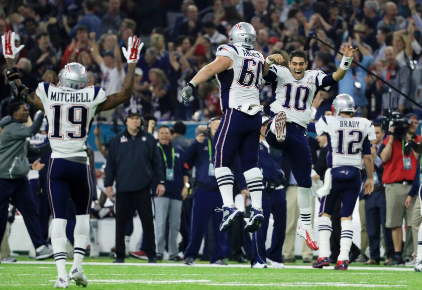 Patriots players celebrate after defeating the Atlanta Falcons in overtime of Super Bowl LI.