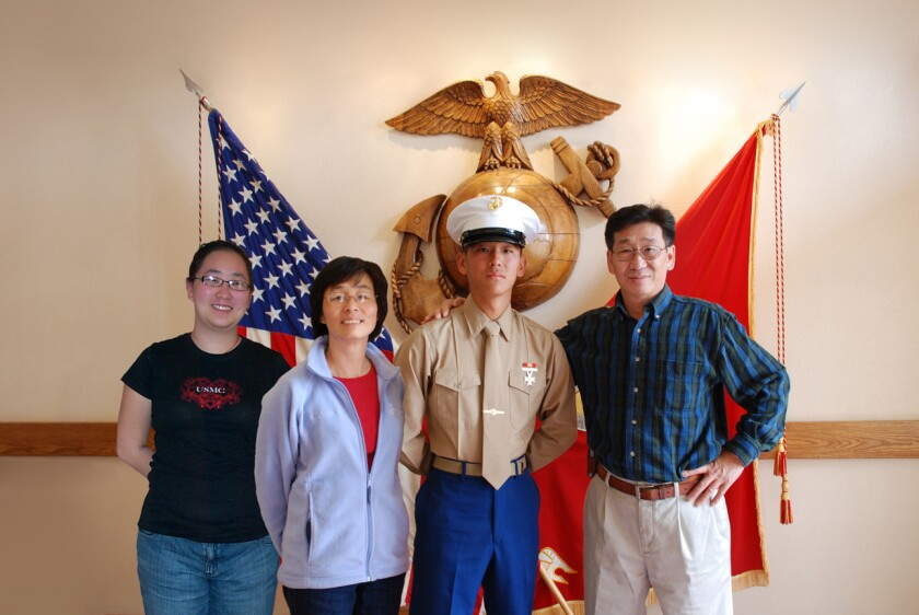 Lance Cpl. Harry Lew, and his family pose for a picture after he joined the Marines. Lew, the nehew of California Rep. Judy Chu, was always fascinated with the Marines. He killed himself in Afghanistan just months before the end of his tour.