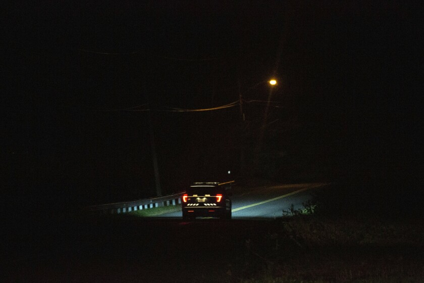A police vehicle on the road leading into Cheshire, Mass., where the police station Matthew Mottor was taken to after failing a breathalyzer test in 2013.  (Patrick Dodson/The New York Times)