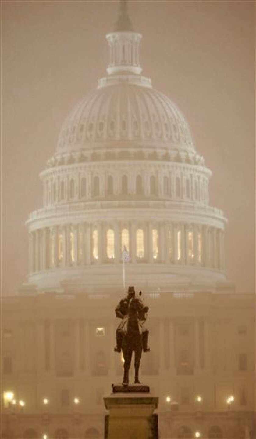 The Ulysses S. Grant Memorial is seen in front of the Capitol in Washington, Friday, Feb. 5, 2010, as snow falls in Washington. Life in the nation's capital ground to a halt Friday as steady snow fell, the beginning of a storm that forecasters said could be the biggest in modern history. (AP Photo/Charles Dharapak)