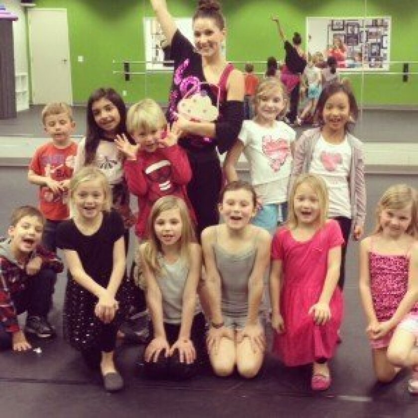 Jenna Saylor, owner of Inspired Movement Dance and Performing Arts, with some of her students. Courtesy photo