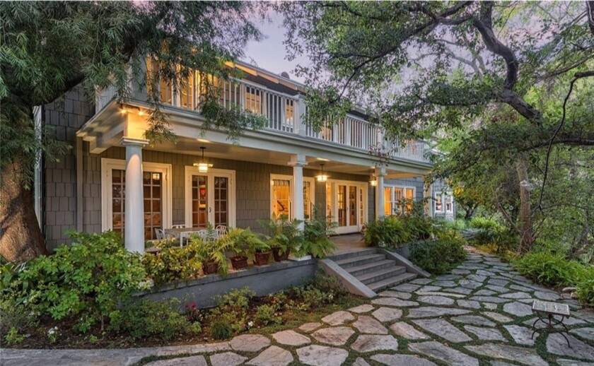 Spanning nearly two acres, the gated estate has a two-story home with Colonial and Craftsman vibes.