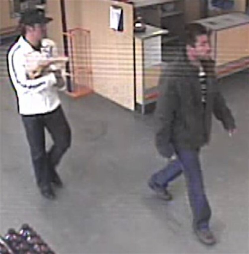 This image taken from video provided by the FBI on Thursday, May 7, 2009, shows two men suspects believed to be responsible for the abduction of Briant Rodriguez from his family home in San Bernardino, Calif., four days ago. A San Bernardino County Sheriff's spokesman says the image came from a surveillance camera in a store near the home. (AP Photo/FBI)
