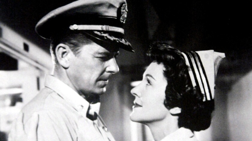 "Ronald Reagan and Nancy Davis in a scene from their 1957 film ""Hellcats of the Navy."""