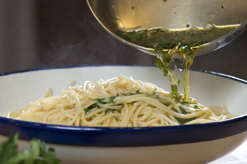 Chef Evan Kleiman makes aglio e olio, a simple pasta dish with olive oil, garlic, lemon, pepper flakes and parsley.