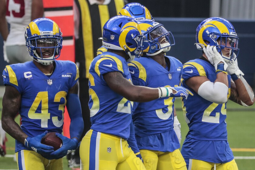 Rams cornerback Darious Williams grimaces walking off the field with his teammates.