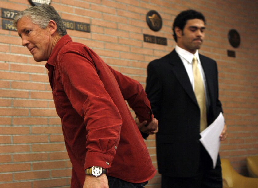 Then-USC coach Pete Carroll, left, shakes hands with quarterback Mark Sanchez after the quarterback announced his decision to turn pro in January 2008.