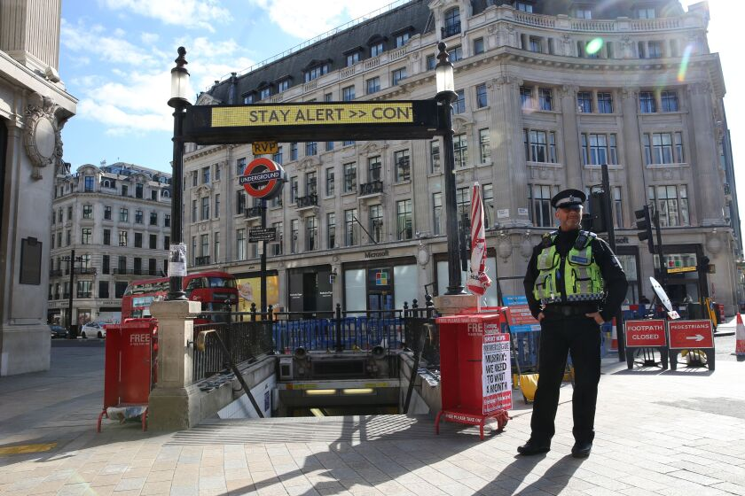 A police officer on duty at the Oxford Circus Tube station entrance in London on May 14, 2020. Britain has eased coronavirus lockdown restrictions.