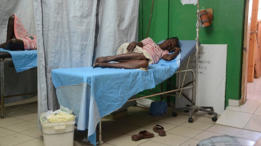 A patient awaits treatment inside the three-stretcher emergency room at St. Catherine Laboure Hospital, in 2012.