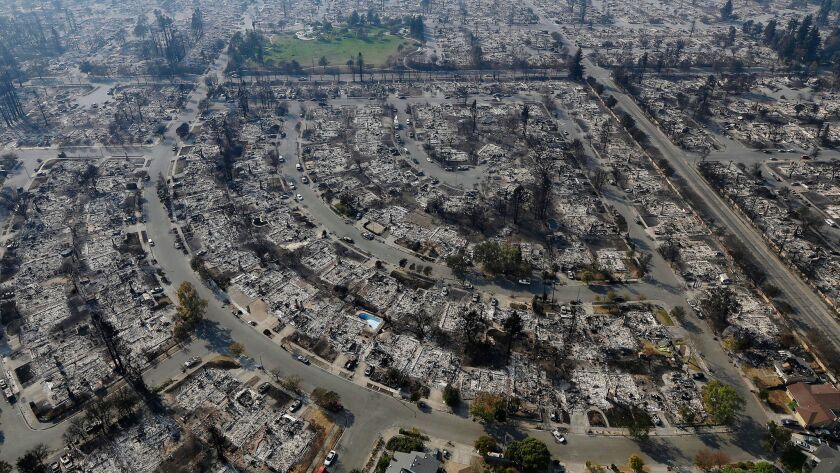 Insurance claims for last year's deadly California wildfires have reached $11.8 billion, Insurance Commissioner Dave Jones said Wednesday. Santa Rosa homes burned by a wildfire are show in this file photograph.