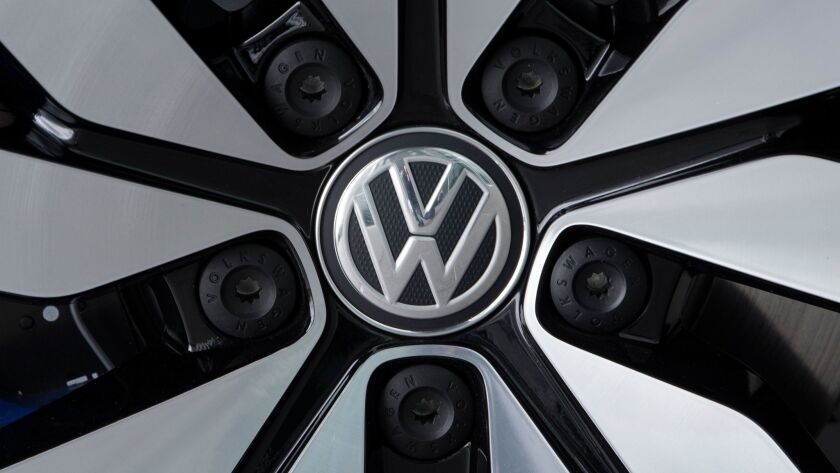 FILE - In this April 28, 2017 file photo an e-Golf electric car with the VW logo on a rim is picture