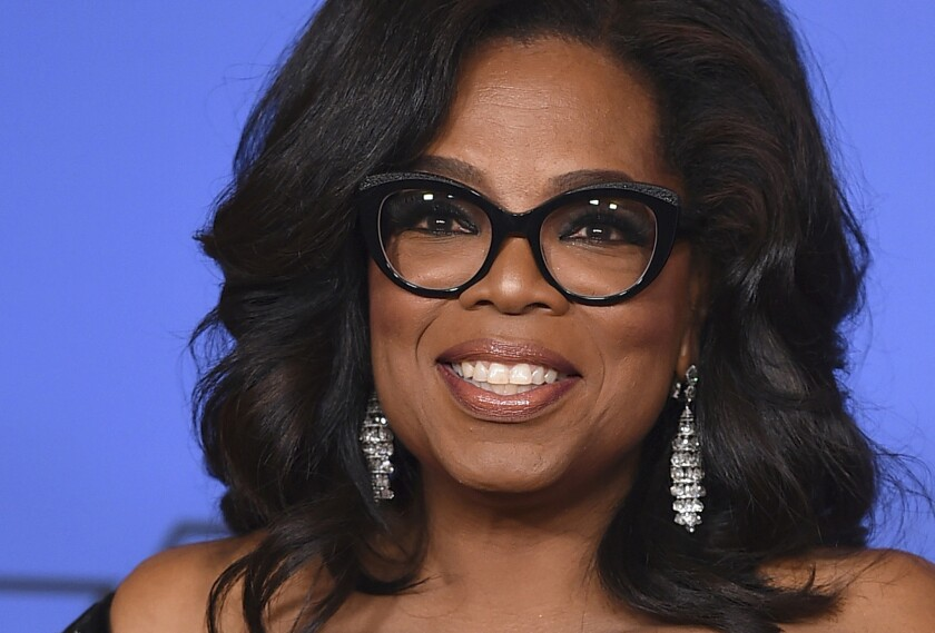 """Oprah Winfrey poses in the press room with the Cecil B. DeMille Award at the 75th annual Golden Globe Awards in Beverly Hills, Calif., on Jan. 7, 2018. Winfrey is praising the outspoken students of Parkland, Fla., calling them """"warriors of the light."""""""