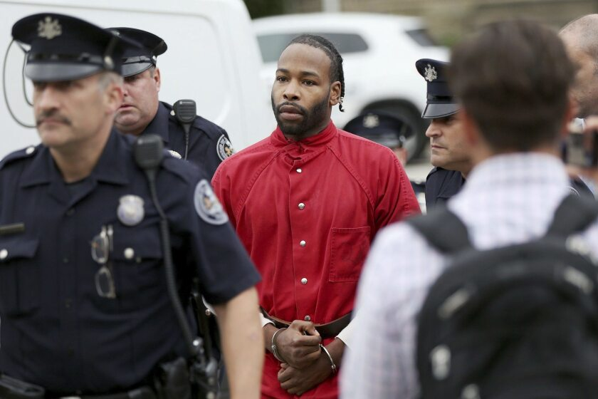 Jonathan Harris, who is accused of killing model Christina Carlin-Kraft on Aug. 22, is escorted into court on Friday.