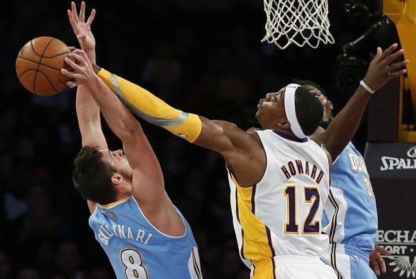 Dwight Howard blocks Nuggets forward Danilo Gallinari's shot.
