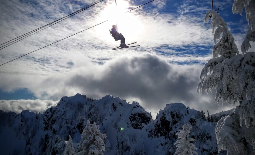 The Edelweiss chairlift at Alpental near Snoqualmie Pass takes skiers into steep powder terrain.