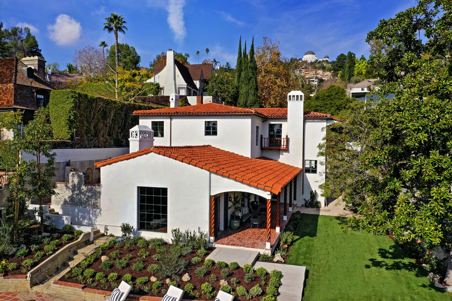 The walled and gated compound, once home to the Rev. Louis H. Evans, the organizing pastor of Bel-Air Presbyterian Church, was built in 1929 and recently renovated and restored. Listed for $4.877 million, the Spanish Colonial-style residence features such original details as handcrafted hardware, antique tilework and cast-iron windows. A two-story entry gives way to a living room set beneath cathedral-style ceilings. A breezeway connects the multilevel residence to a guest apartment above the garage. (Jo David / Charmaine David Photography)