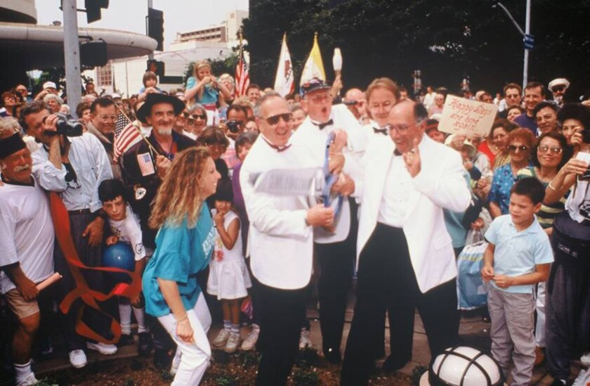 Cutting the celebratory ribbon on Sept. 16, 1989, for the Santa Monica Third Street Promenade are (from left) Adele Diamond; Herb Katz; Thomas Carroll, head of downtown manager Bayside District Corp.; Denny Zane and Ernest Kaplan, chairman of the Bayside District board.