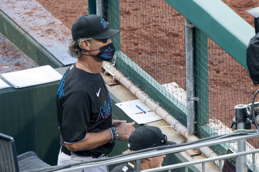Marlins manager Don Mattingly looks out from the dugout during the July 25 game against the Phillies.